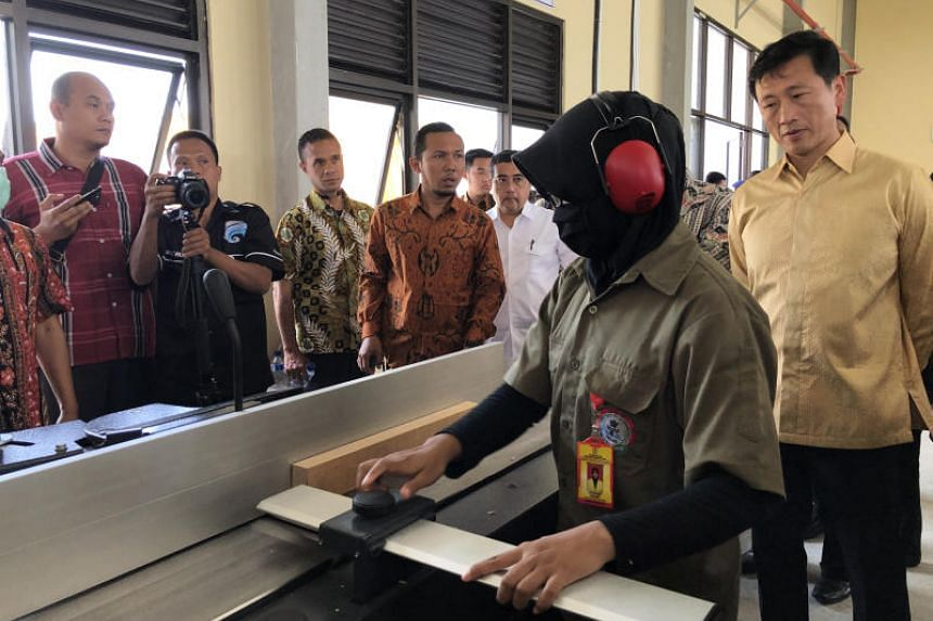 Education Minister Ong Ye Kung touring the new Kendal Furniture and Wood Processing Industry Polytechnic in Kendal, Indonesia, on Jan 10, 2019.