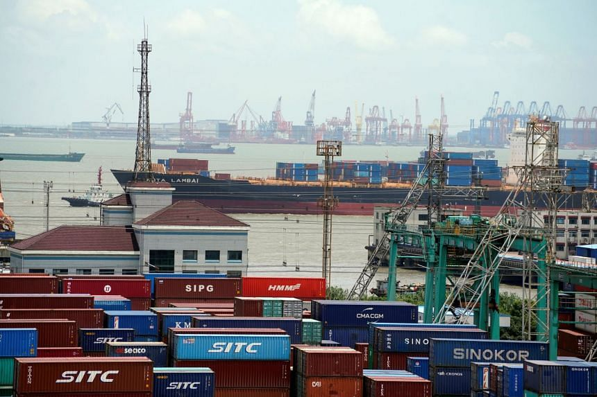 Shipping containers are seen at a port in Shanghai, China.