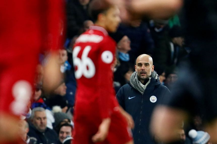 Guardiola looks on as Manchester City take on Liverpool.