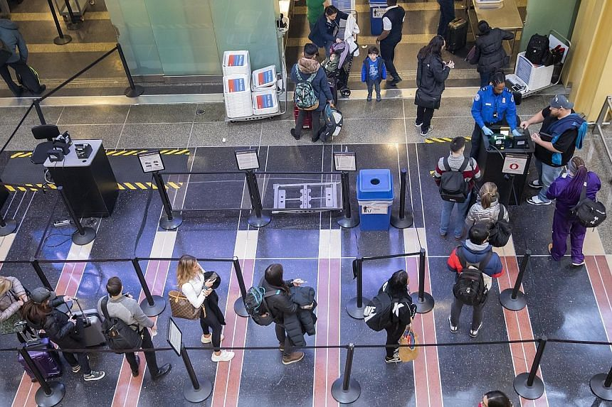 A Transportation Security Administration agent checking travellers' identification at Ronald Reagan Washington National Airport in Virginia on Monday.