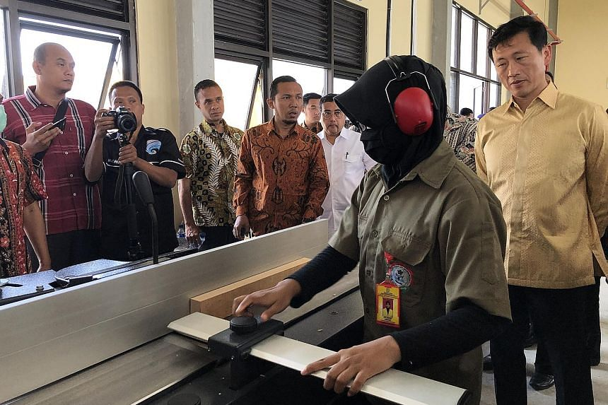 Education Minister Ong Ye Kung touring the workshop at Kendal Furniture and Wood Processing Industry Polytechnic, one of Indonesia's newest polytechnics. Indonesia's Industry Minister Airlangga Hartarto said the government is committed to building mo