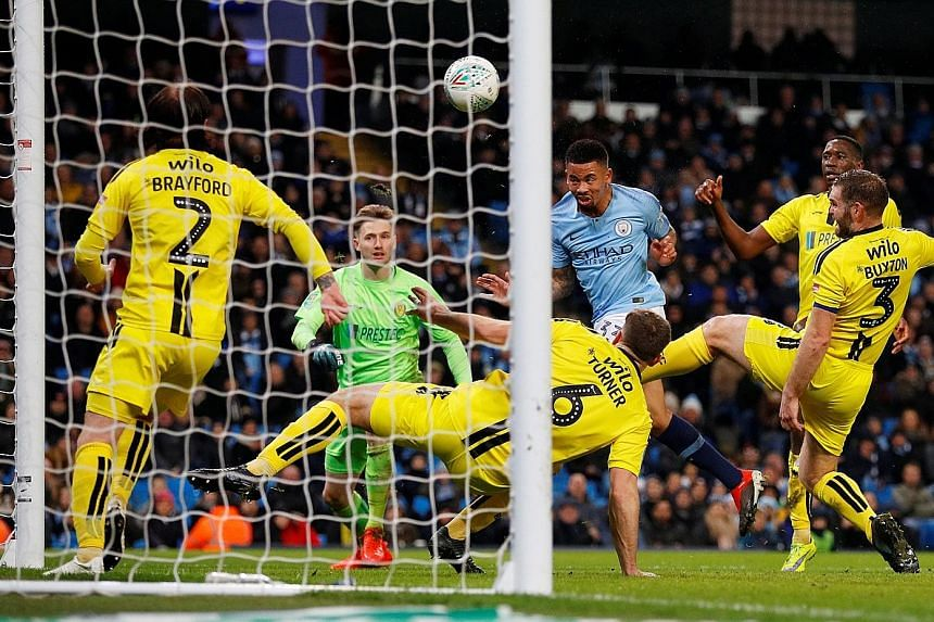 Manchester City's Gabriel Jesus heading home the first of his four goals against Burton in the first leg of their League Cup semi-final. City's nine-goal advantage all but secures their spot in the final.