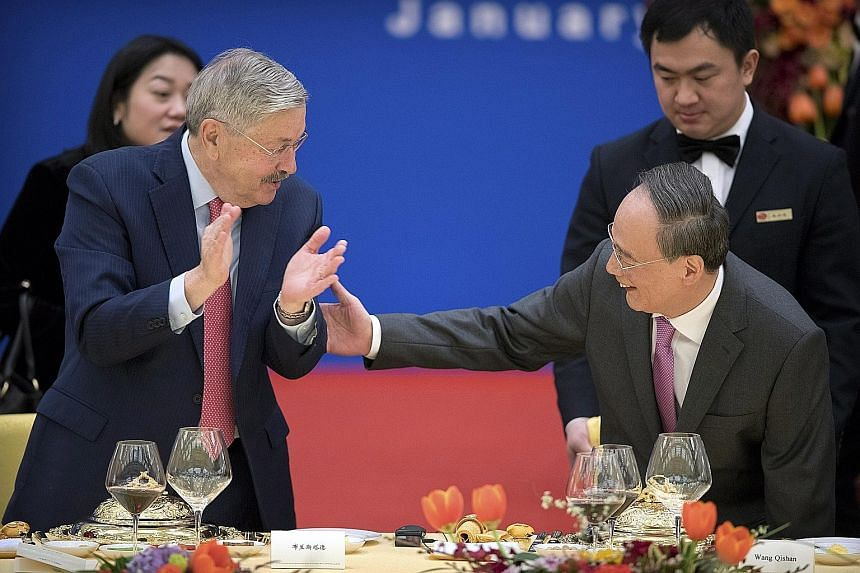 American Ambassador to China Terry Branstad and China's Vice-President Wang Qishan at an event to commemorate the 40th anniversary of the establishment of diplomatic relations between the United States and China, in Beijing yesterday.