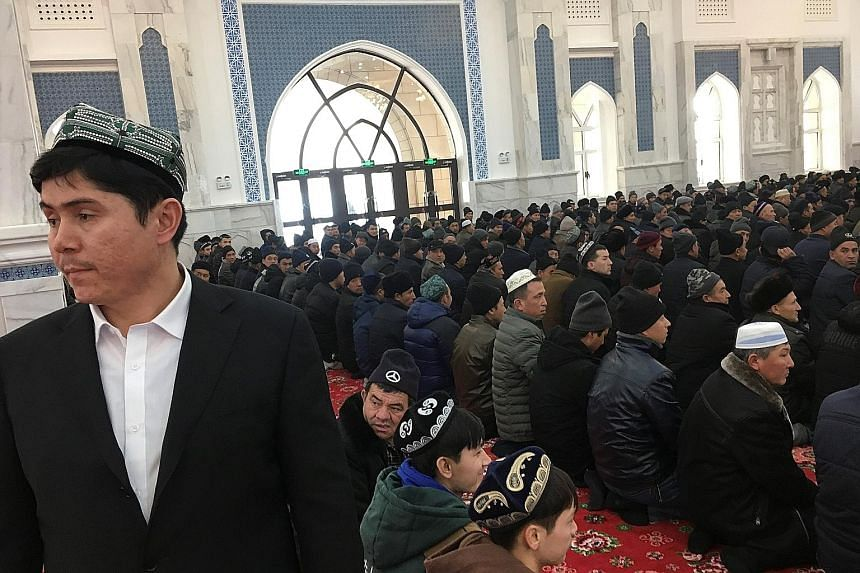 Worshippers in the mosque at the Xinjiang Islamic Institute during a Chinese government-organised trip last week in Urumqi, Xinjiang.