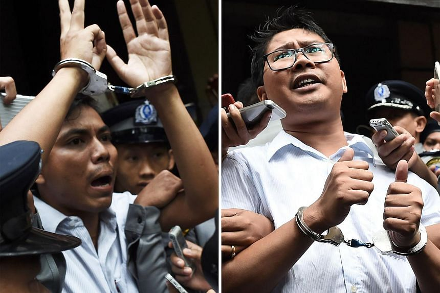 Reporters Kyaw Soe Oo (left) and Wa Lone were arrested in Yangon in December 2017 and later sentenced to seven years in jail for violating the state secrets act.