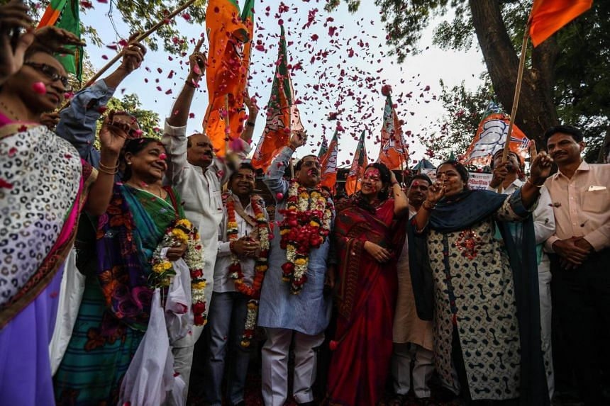 Members of Bharatiya Janta Party celebrate after the Parliament passed the reservation bill in Mumbai, India, on Jan 10, 2019.