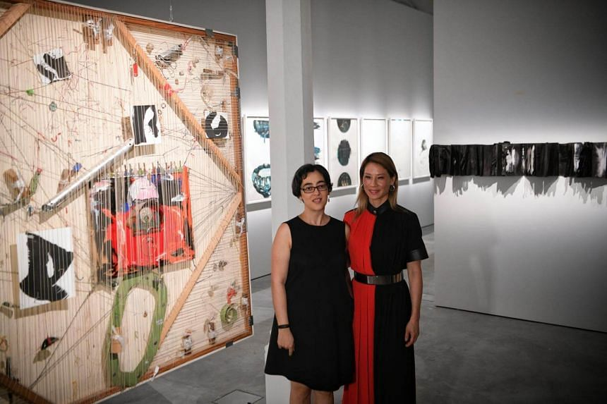 Lost And Found, is one of the artworks on show at Unhomed Belongings, a joint exhibition Hollywood actress Lucy Liu (right) is holding with Singaporean artist Shubigi Rao.