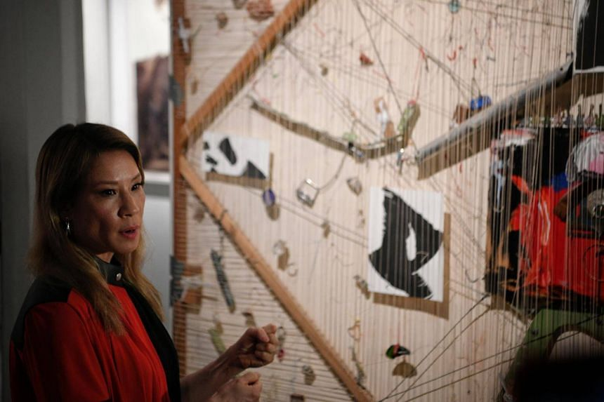 Award-winning Hollywood actress and artist Lucy Liu talks about one of her art pieces on show at Unhomed Belongings, an exhibition at the National Museum of Singapore, on Jan 10, 2019.
