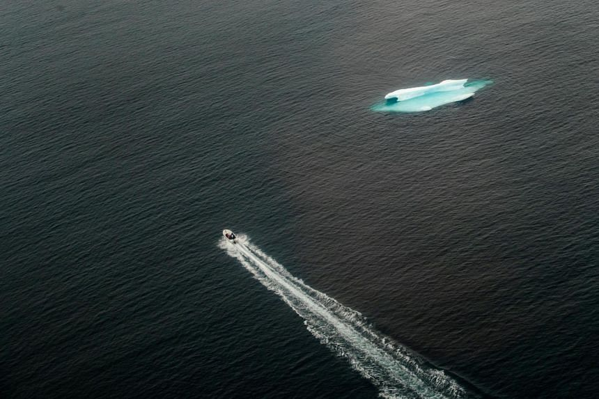 An iceberg floats in the open ocean near Tasiilaq, Greenland, on June 24, 2018. About 93 per cent of excess heat - trapped around the Earth by greenhouse gases that come from the burning of fossil fuels - accumulates in the world's oceans.