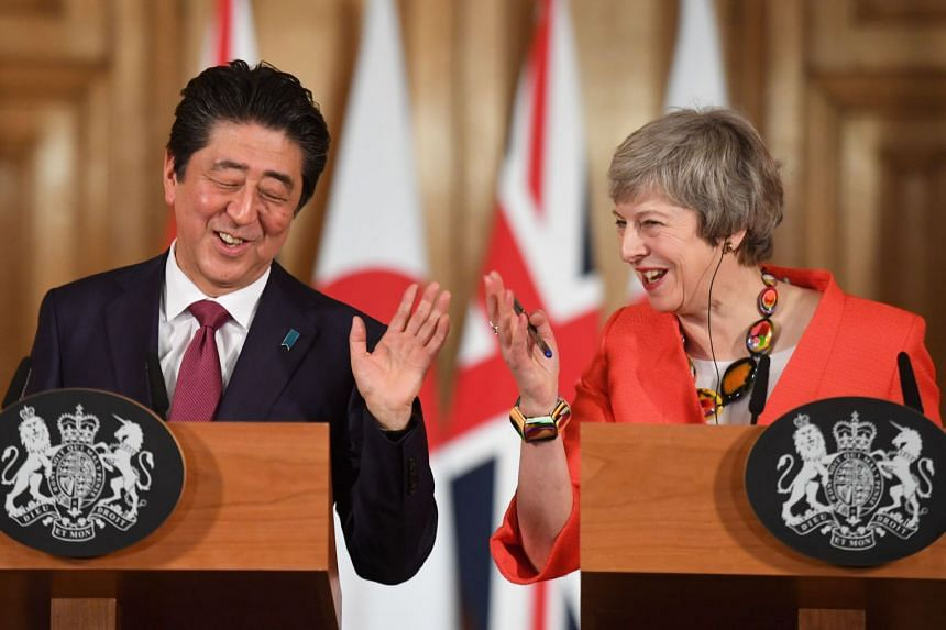 British Prime Minister Theresa May (right) and Japan's Prime Minister Shinzo Abe hold a joint press conference.