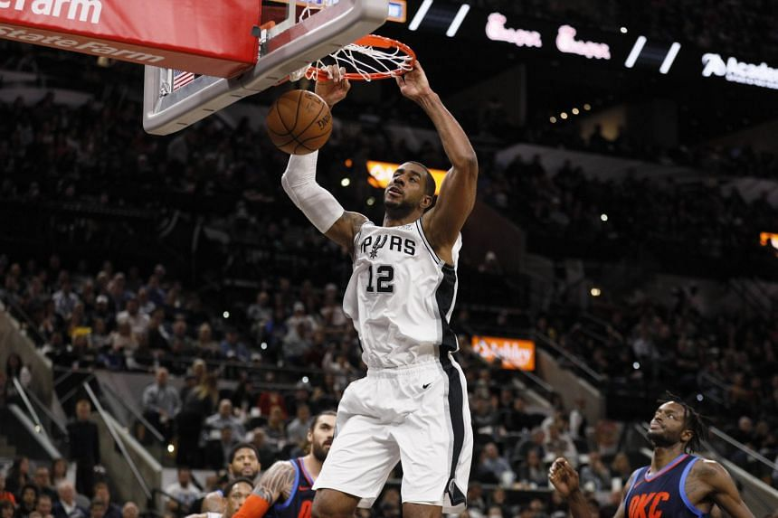 San Antonio Spurs' LaMarcus Aldridge dunks the ball against the Oklahoma City Thunder during the first half at AT&T Center in San Antonio on Jan 10, 2019.