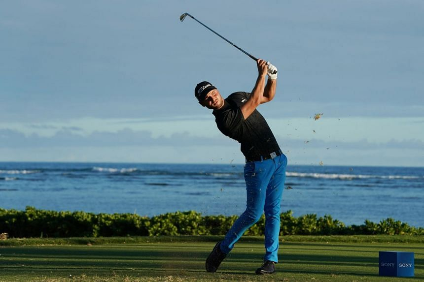 Adam Svensson tees off on the 17th hole during the first round of the Sony Open in Hawaii golf tournament at Waialae Country Club, in Hawaii on Jan 10, 2019.