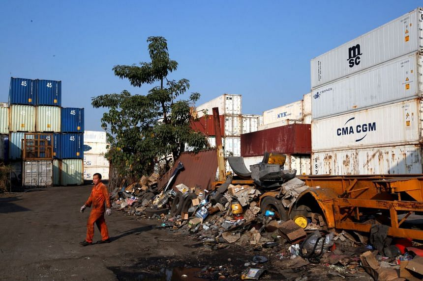 A plot of rural land in Hong Kong's New Territories hinterland, owned by a developer and being used as a yard for containers and scrap.