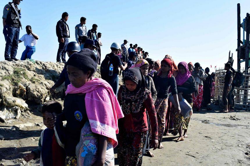 A file photo taken on Nov 30, 2018, shows Myanmar Navy personnel escorting Rohingya Muslims back to their camp in Sittwe, Rakhine state.