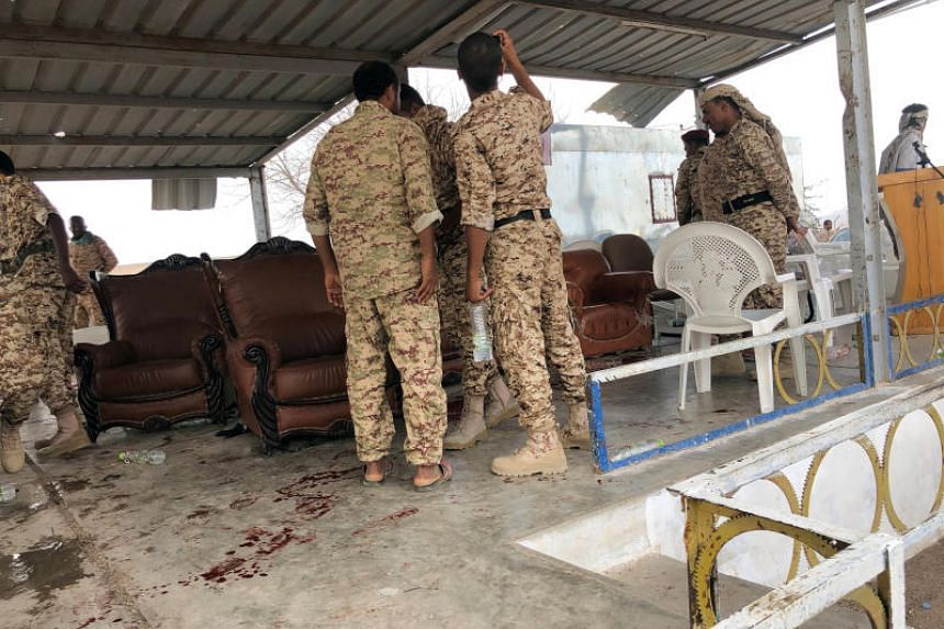 Soldiers inspect the scene of a Houthi drone attack at a Yemeni government military parade in al-Anad air base, Lahaj province, Yemen, on Jan 10, 2019.