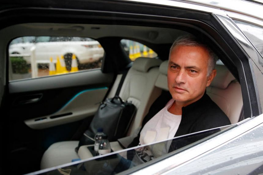 Jose Mourinho is driven away from his accommodation after leaving his job as Manchester United's manager, in Manchester, Britain, on Dec 18, 2018.