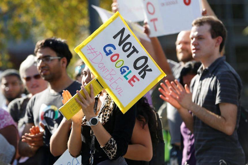 "A Google employee holds a sign during a ""women's walkout"" at their Googleplex offices in protest over the company's handling of a large payout to Android chief Andy Rubin as well as concerns over several other managers who had allegedly engaged in se"