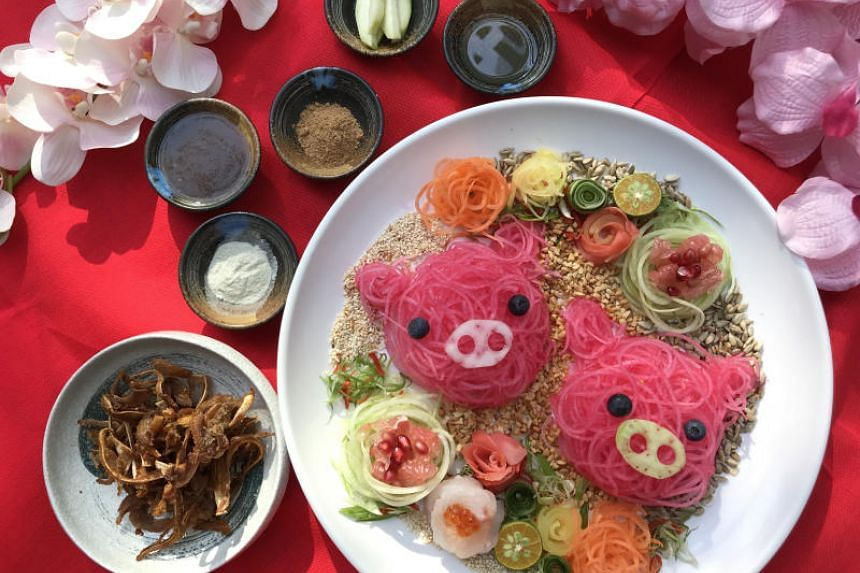 Fat Chap's Ear of the Pig Yusheng features green and white daikon, freshly sliced golden snapper sashimi, pomegranate, pomelo and a side of curry-spiced crispy pig's ears.