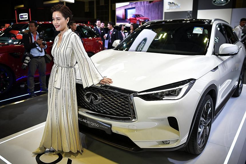 Nissan's Infiniti is one. Its QX50 (above, with actress Zoe Tay) boasts the world's first production variable compression ratio turbo engine.