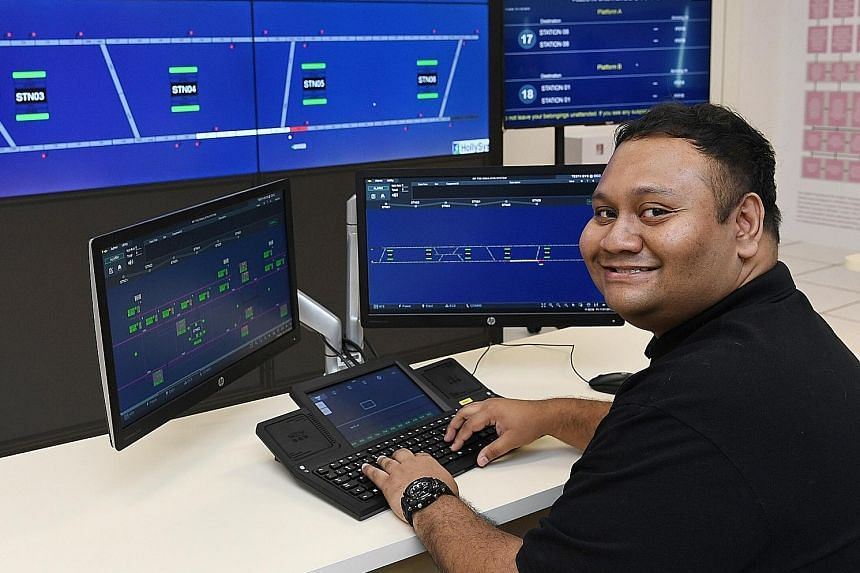 Republic Polytechnic (RP) graduate Muhammad Syahirul Annuar Musa in the RP-LTA Rail Operations Management Lab yesterday. RP signed an MOU with LTA, SMRT and SBS Transit to commit to developing the local land transport industry workforce and to growin