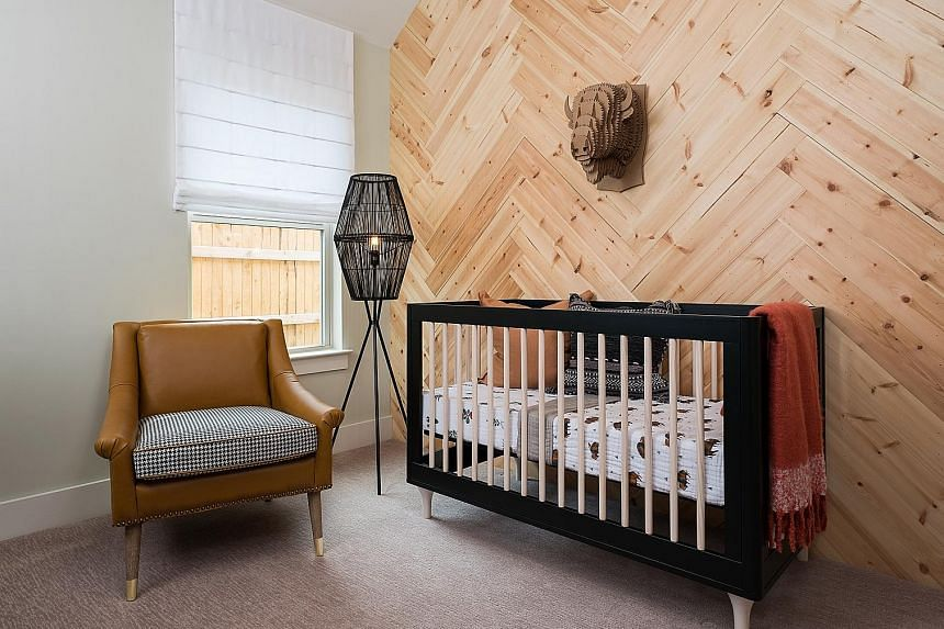 (Top) A wall of wood adds a rustic touch to this nursery. (Above) If installing wood in a bathroom, choose one more resistant to mould. A room with a high ceiling can seem cold. But wood can be used to warm it up.