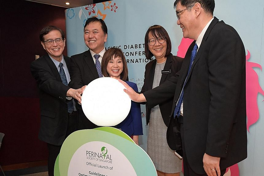 From left: Professor Tan Kok Hian; Professor Alex Sia, CEO of KK Women's and Children's Hospital (KKH); Senior Minister of State for Health Amy Khor; Dr Chua Mei Chien; and Associate Professor Ng Kee Chong, chairman of the medical board at KKH, at th