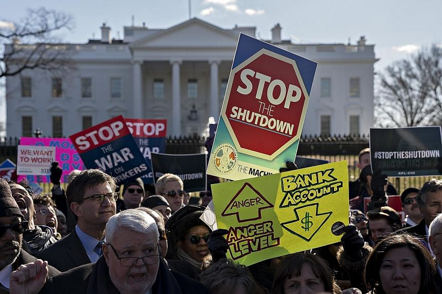Demonstrators, union members and federal employees at a rally outside the White House on Thursday to call for an end to the partial government shutdown.