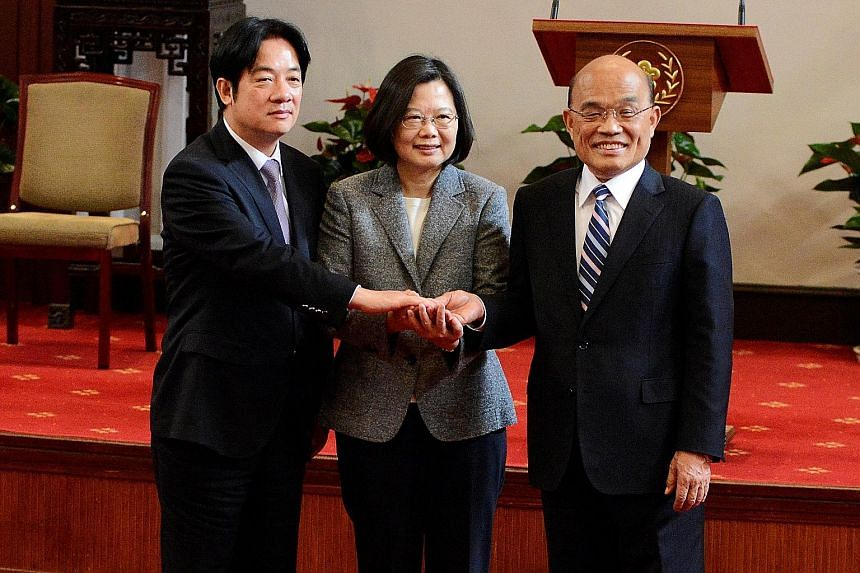 Taiwan President Tsai Ing-wen flanked by former premier William Lai (far left) and new premier Su Tseng-chang after a news conference in Taipei yesterday. The new administration will be tasked with winning back public support after the Democratic Pro