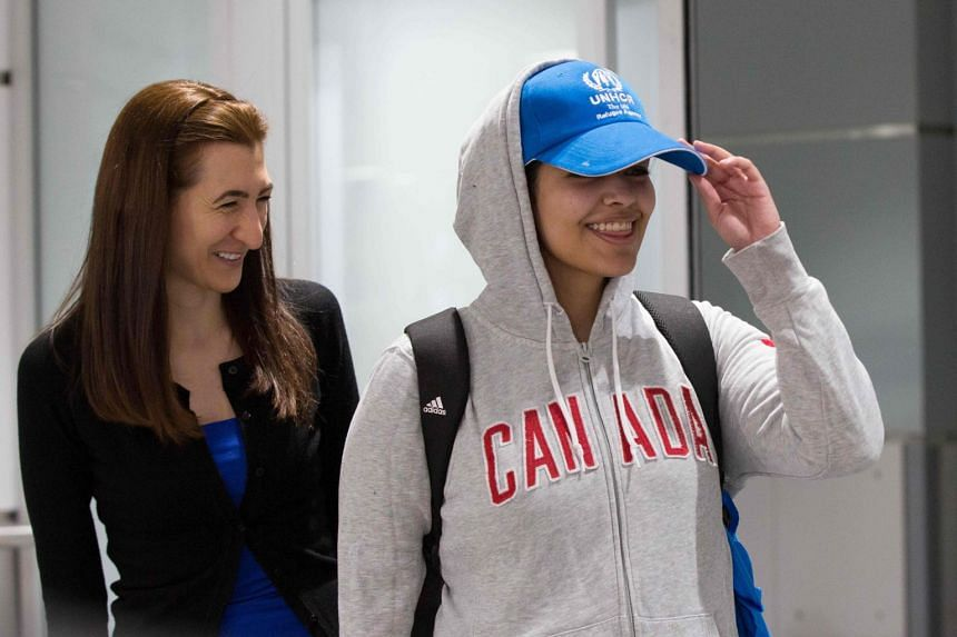 Saudi teenager Rahaf Mohammed al-Qunun (right) arrives at Pearson International airport in Toronto.