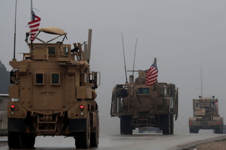 File photo of US military vehicles in Syria's northern city of Manbij.