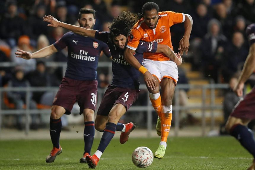Arsenal's Mohamed Elneny in action with Blackpool's Nathan Delfouneso, on Jan 5, 2019.