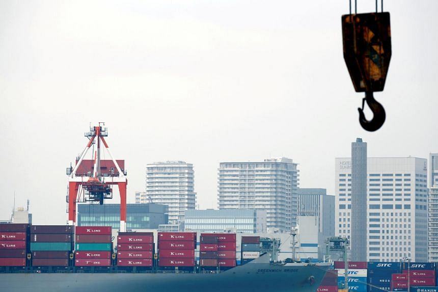 File photo of a cargo ship at an industrial port in Tokyo, on Aug 18, 2016.