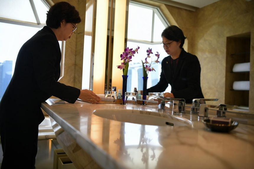 Ms Low Chee Mung, 50, executive housekeeper of the Ritz-Carlton hotel, uses lemon and salt to sanitise chopping boards and remove dirt.