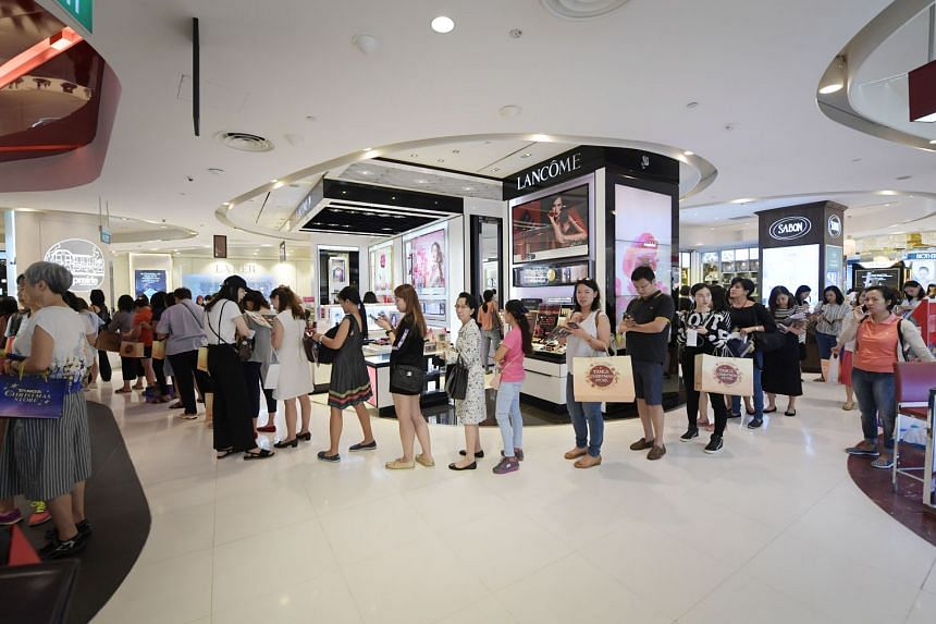 A queue for beauty vouchers at Tangs in Orchard Road on Black Friday, Nov 23 last year. Department stores registered a rise of 8.7 per cent in sales compared with the same period in 2017, though retail sales fell 3 per cent.