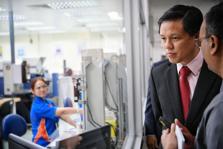 Trade and Industry Minister Chan Chun Sing at the official opening of Becton Dickinson's Tuas plastic moulding centre yesterday. The centre is part of the US medical equipment maker's $7 million transformation plan.
