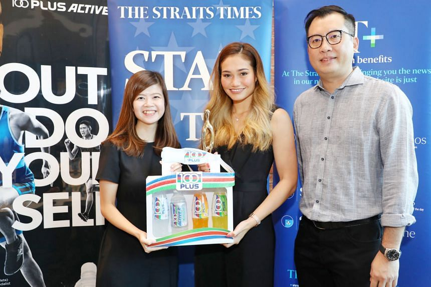 Silat exponent Nurul Suhaila Saiful, The Straits Times Star of the Month for December, receiving her award from F&N Foods brand manager Shannon Sia. With them is ST deputy sports editor Lim Han Ming.