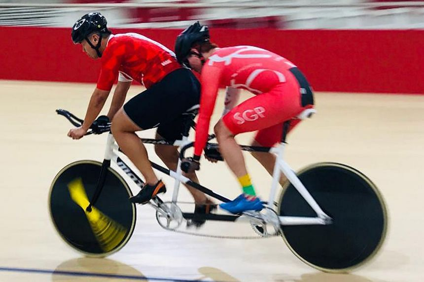 Singaporean para-cyclist Tee Wee Leong and his pilot Ang Kee Meng on the way to clinching Singapore's first medal at the 8th Para Asian Track Championships in Jakarta yesterday. The tandem cyclists clocked 4min 50.016sec in the men's 4,000m individua