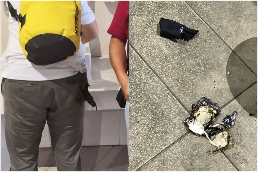 Photos show the badly burnt and melted remains of the power bank on the floor, as well as a large frayed hole in the man's back pocket.