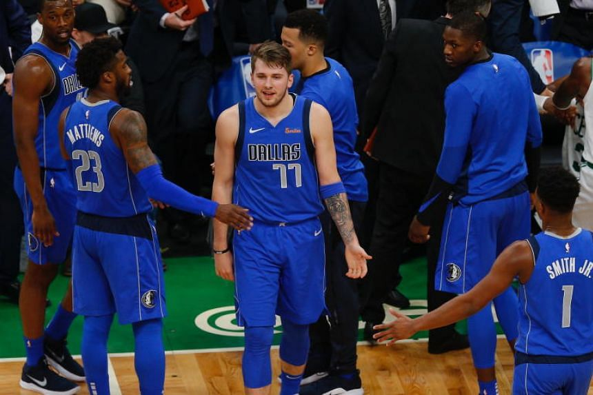 Dallas Mavericks forward Luka Doncic is congratulated by his teammates after the game against the Boston Celtics, on Jan 4, 2019.