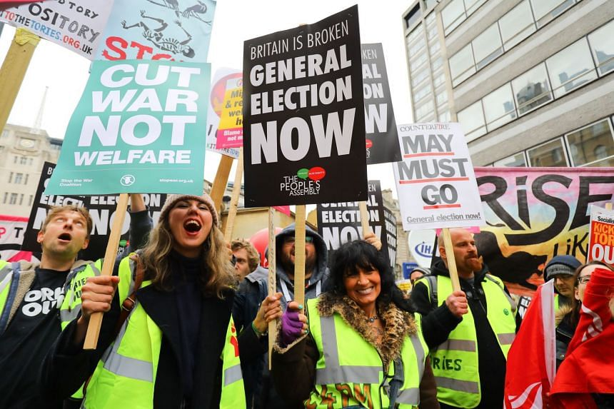 Demonstrators take part in the People's Assembly Against Austerity march and protest in London.