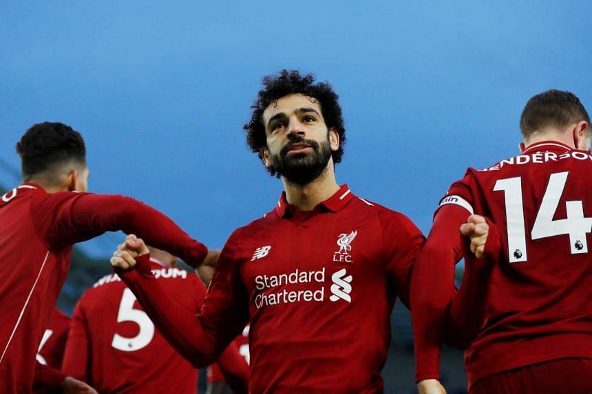 Salah celebrates scoring for Liverpool.