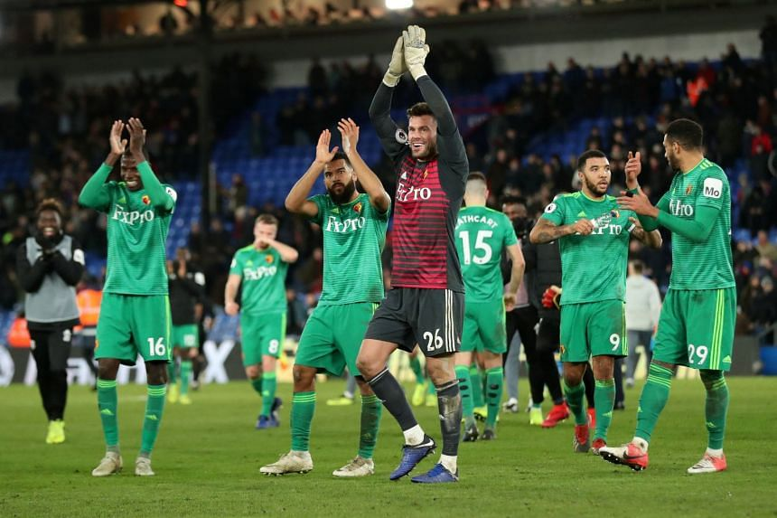 Watford's Ben Foster celebrates after the match with team mates.