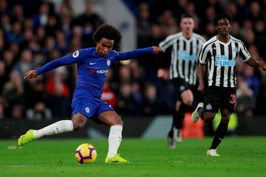 Chelsea's Willian shoots at goal in their match against Newcastle United.