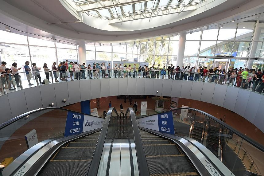 People queueing to enter the new library@harbourfront, which was officially opened yesterday in VivoCity mall. Spanning 3,000 sq m, it is the biggest of 13 libraries located in a mall here.