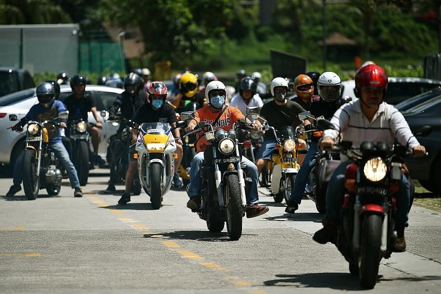 A group of 60 motorcyclists getting ready to begin their ride from a carpark at Orto, a leisure park near Sembawang, to the Wicked Wallop IV bike show in Kranji. The convoy consists largely of older motorcycles registered before July 1, 2003, which a