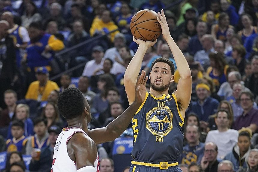 Golden State Warriors guard Klay Thompson knocked down three straight three-pointers in the first 70 seconds of the game against the Chicago Bulls. His 30 points helped the Warriors power to a 146-109 beatdown of Chicago at the Oracle Arena on Friday
