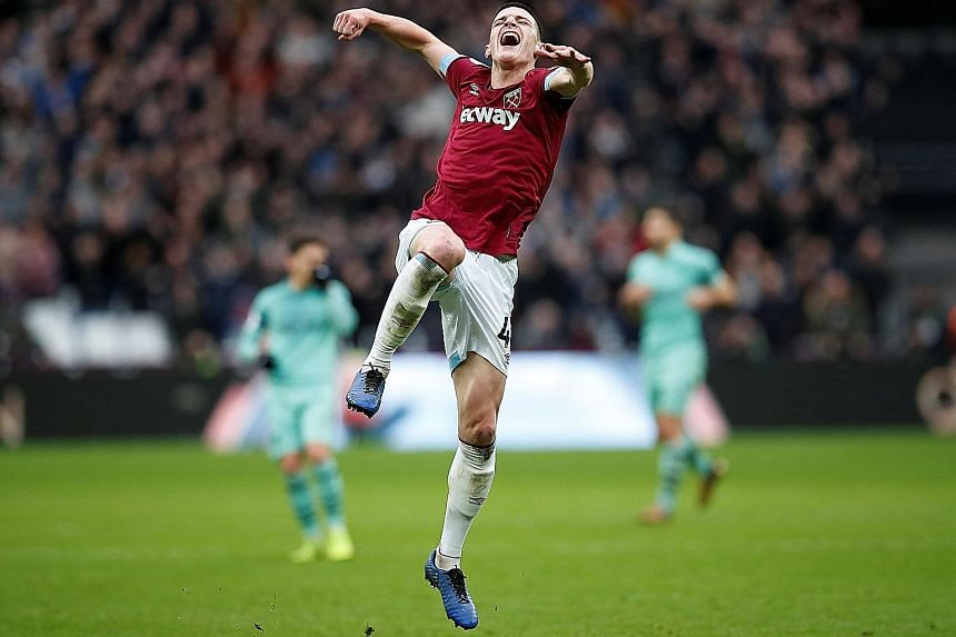 West Ham United's Declan Rice, who turns 20 tomorrow, jumps for joy after the final whistle at the London Stadium yesterday. His 48th-minute goal earned the Hammers a thoroughly deserved 1-0 win over the Gunners. It was West Ham's first home victory