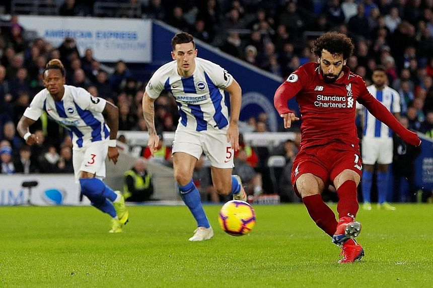 Mohamed Salah putting away the 50th-minute penalty he earned at Brighton yesterday after being hacked down by midfielder Pascal Gross. It earned the Premier League leaders their first win this year, after setbacks at champions Manchester City in the