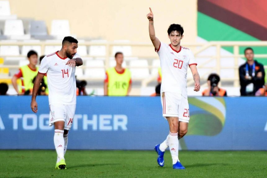 Iran's forward Sardar Azmoun (right) celebrates his second goal during the 2019 AFC Asian Cup group D football match between Vietnam and Iran at the al-Nahyan Stadium in Abu Dhabi, on Jan 12, 2019.
