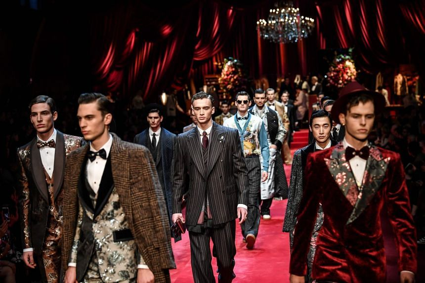 Models present creations for fashion house Dolce & Gabbana during its Men's Fall/Winter 2019/20 fashion show in Milan.